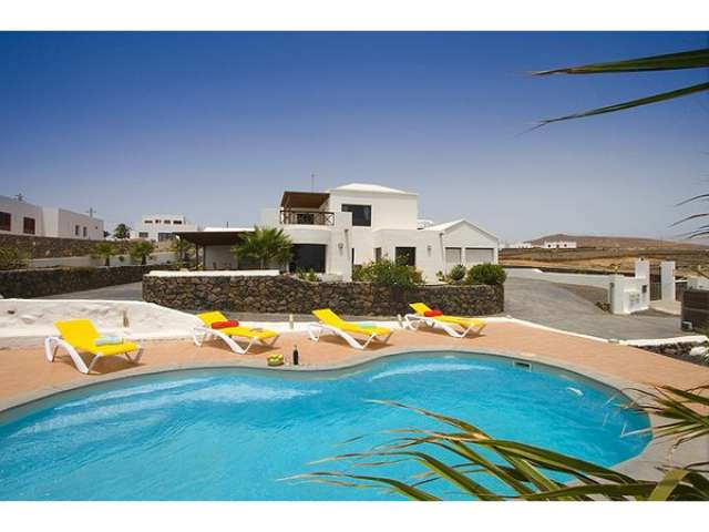 Luxury 4 bedroom holiday villa sleeps 8 with private terrace and sea views in rural location of El Mojon Lanzarote